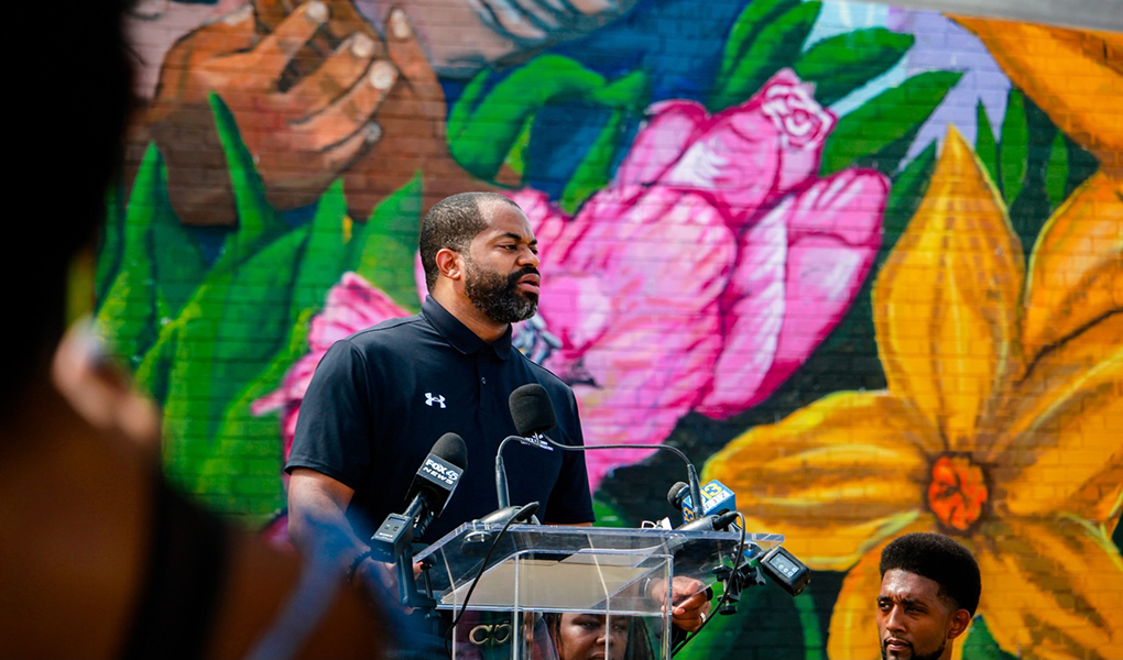 Council President Nick J. Mosby addresses community members at a mural unveiling in East Baltimore.