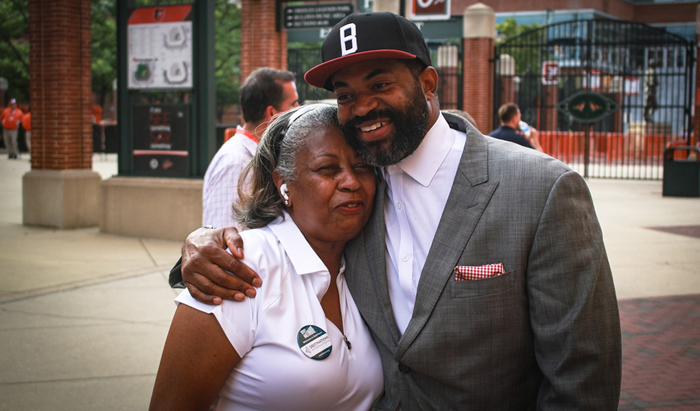 Council President Nick J. Mosby greets residents at Camden Yards.